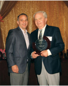 Angelo Sr. and Angelo Jr. accept award cropped
